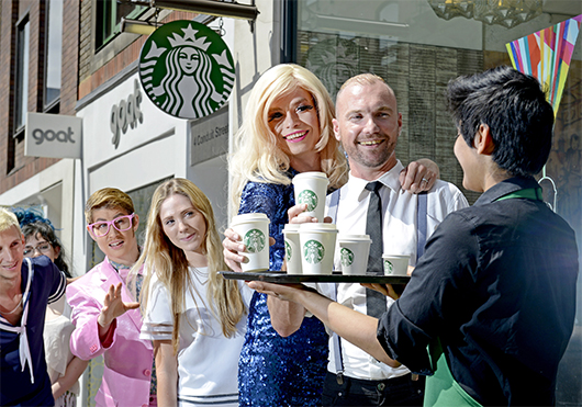 Pride-goers lining up for a Starbucks