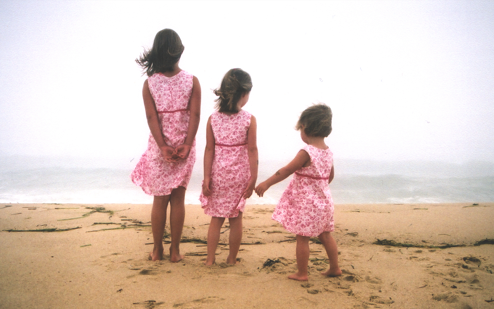 Three sisters on a beach