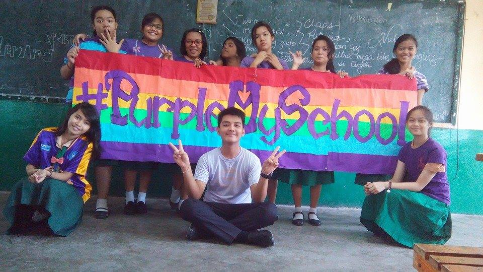 Children from Quezon City High School, Philippines, wear purple in support of LGBTI youth