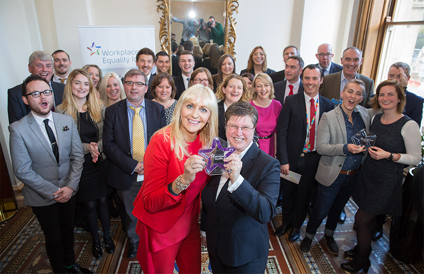 Awards host Miriam O'Callaghan from the RTE TV station with Catherine Vaughan from EY, surrounded by other winners in the GLEN Workplace Equality Index ceremony
