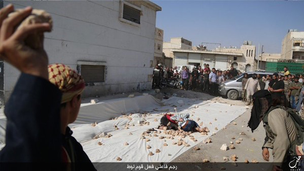 ISIS militants and supporters stone gay men to death in Aleppo, Syria.