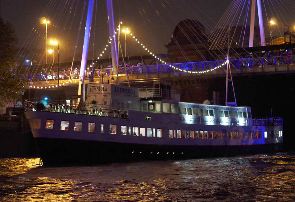 The R.S. Hispaniola is moored near London's Embankment Underground Station