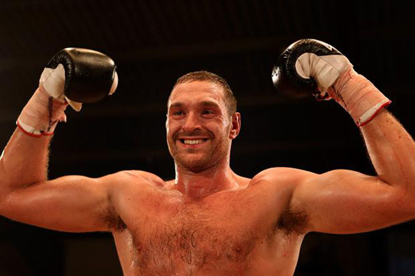 Tyson Fury has kissed a man to prove he's not homophobic