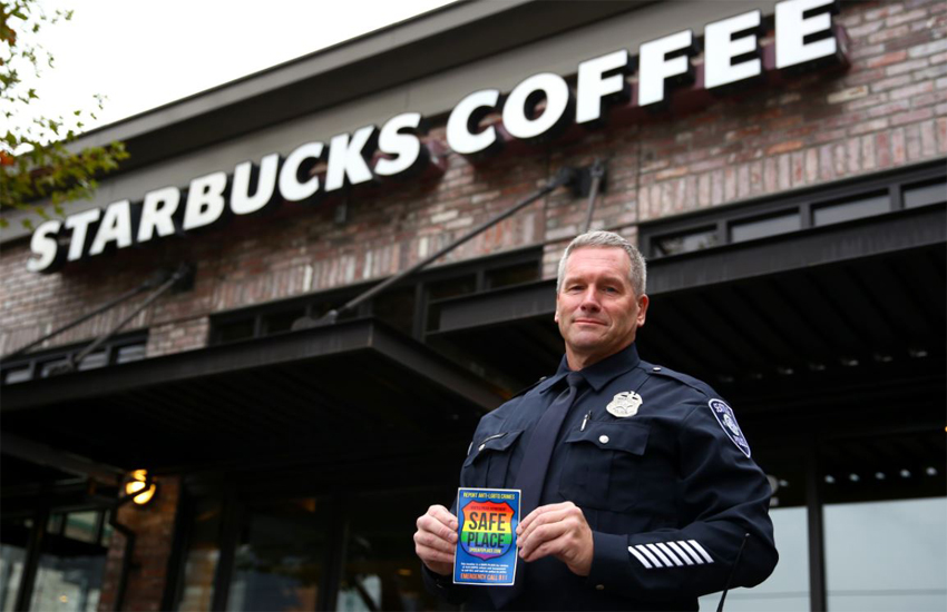 Officer Jim Ritter and a Safe Place sign outside a local Starbucks