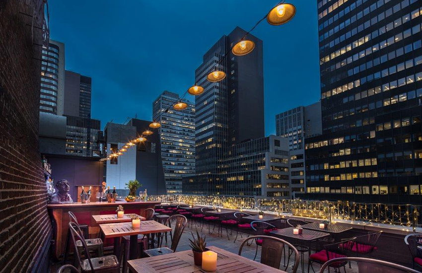 The Roger Smith Hotel boasts a rooftop bar, Henry's