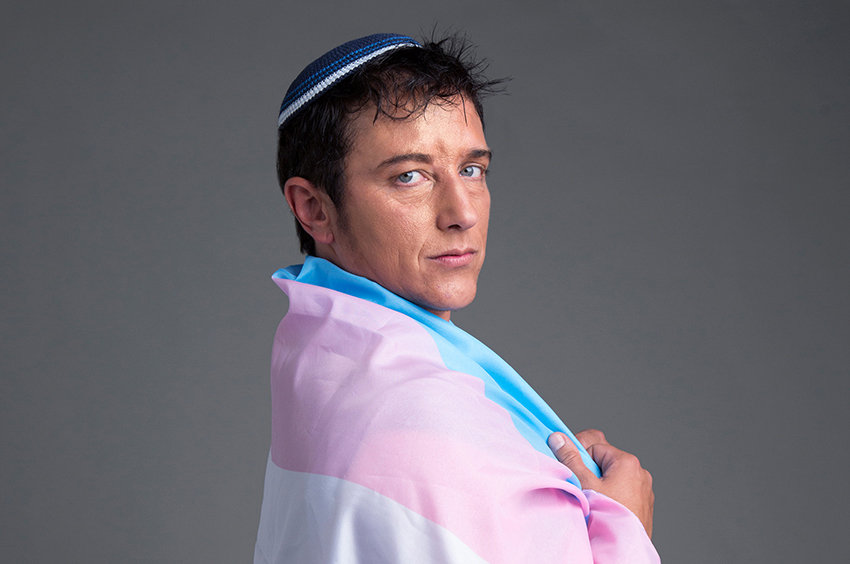 Surat-Shaan Knan wears the trans flag like a 'tallit', a Jewish prayer shawl, for Pride.