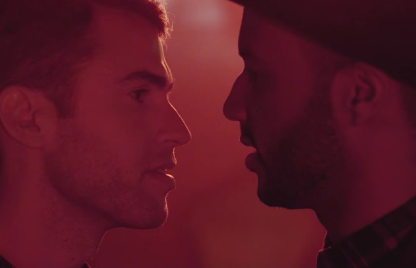 Rayvon Owen (right) kisses boyfriend Shane Bitney Crone in the video for his debut single Can't Fight It