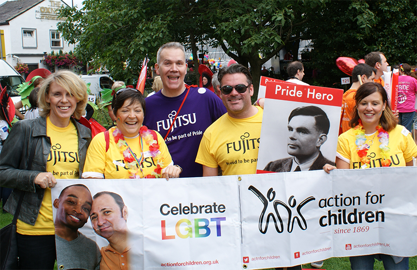 Fujitsu staff demonstrate their support for Action for Children at a Pride event in summer 2015