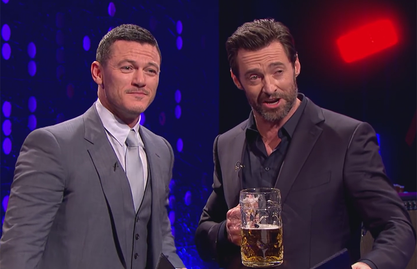 Luke Evans and Hugh Jackman had a Beauty and the Beast-themed sing-off to determine who's best.