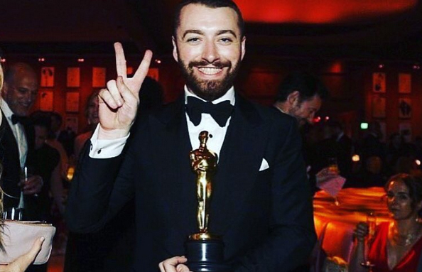 Sam Smith celebrates winning his Academy Award