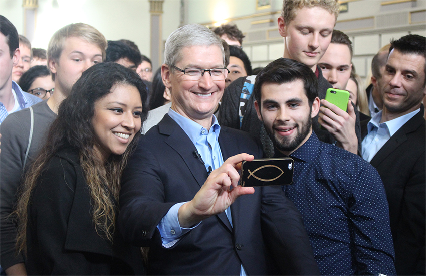Tim Cook with student at Trinity College, Dublin, during a visit in November 2015