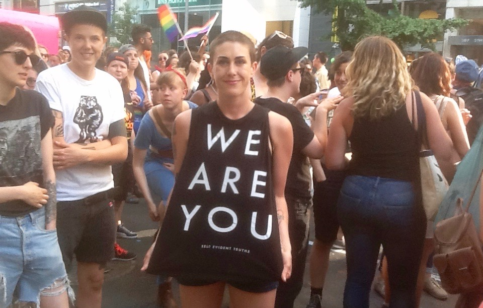 Participant in 2016 New York City Dyke March wearing a 'We Are You' T-shirt