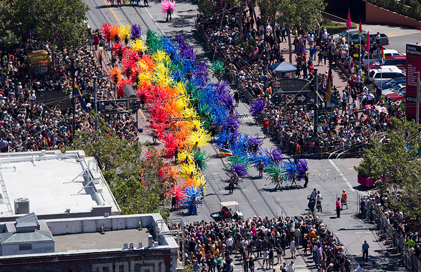 A pride parade marching through the streets of San Francisco google