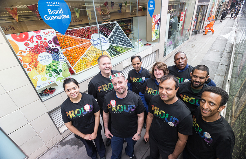 Tesco staff in the brand's Pride T-shirts and a Pride fruit and vegetable display