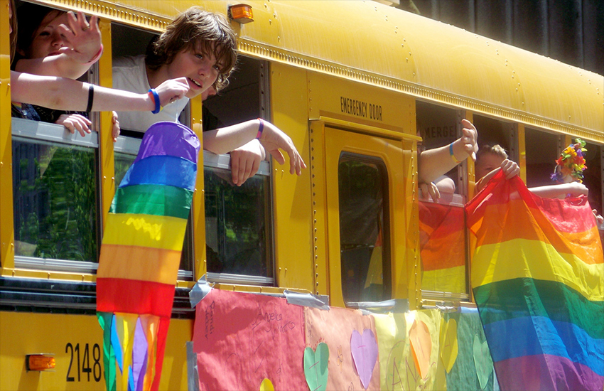 A school bus flies the rainbow flag in support of LGBT students