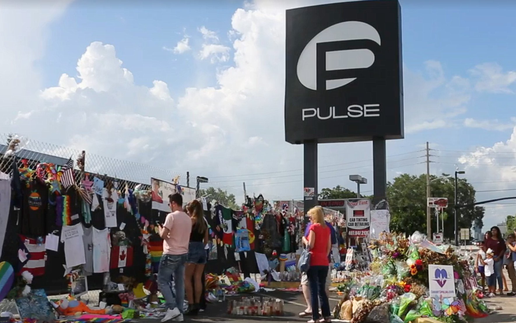 People travel to Pulse nightclub to honor the victims of the massacre