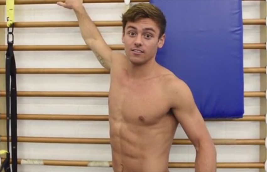 Tom Daley shows one of the reasons why he has such defined abs