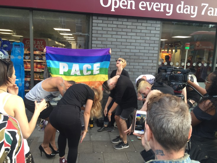 Crowds of people gathered at a Sainsbury's in London to stage a mass kiss-in