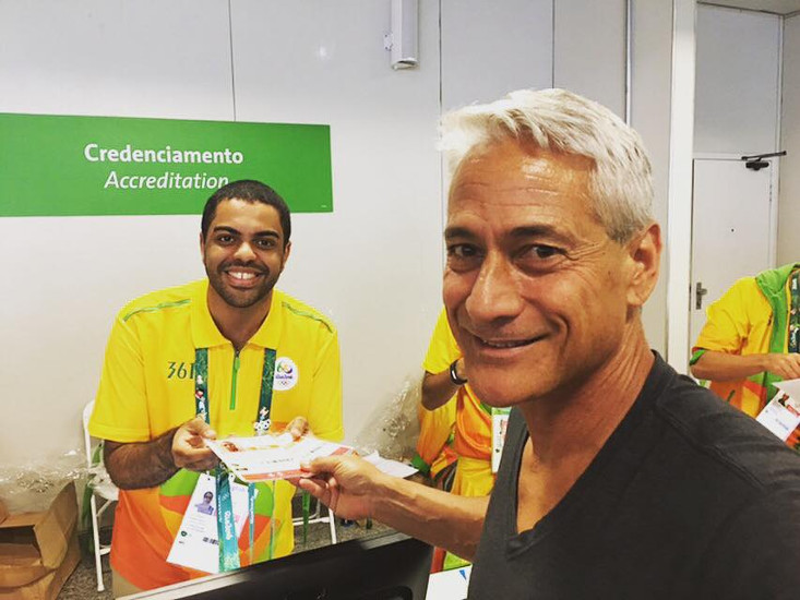 Greg Louganis is among the gay celebrities posting photos on social media from Olympics.