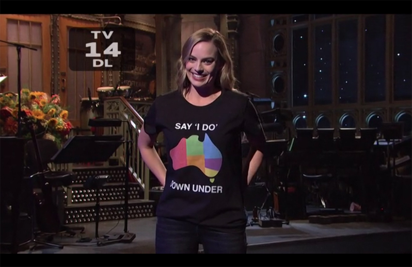 Margot Robbie wearing 'Say I do down under' shirt on Saturday Night Live