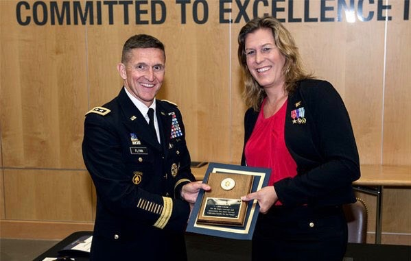 Retired Navy SEAL Kristin Beck with former Defense Intelligence Agency Director Lt. Gen. Michael Flynn in 2014 (r to l)