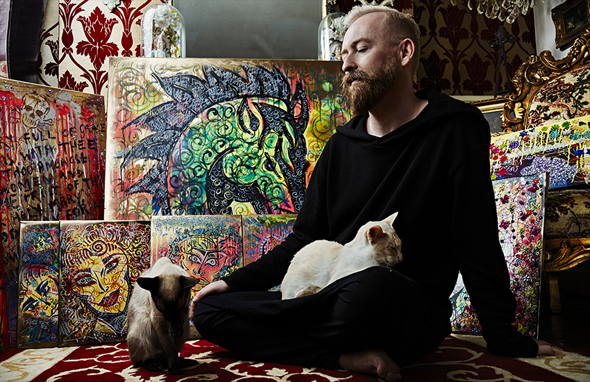 David Hodge, aka Dusty O, at home with some of his artwork