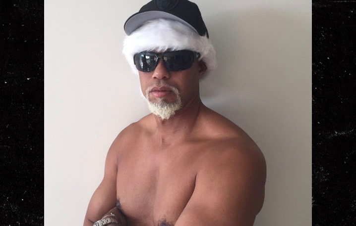 Pro-golfer Tiger Woods goes shirtless as Santa Claus