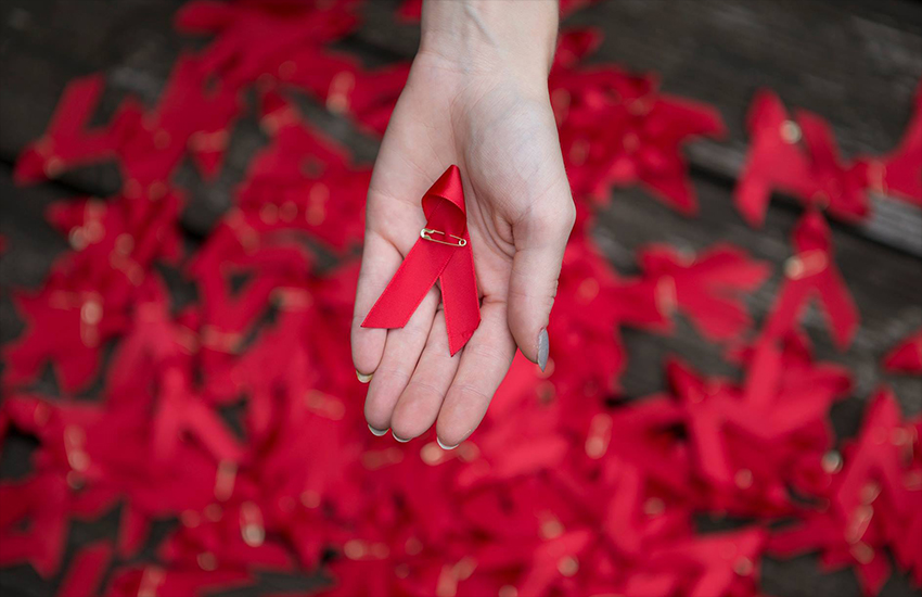 The red ribbon is the international symbol for awareness around HIV infection
