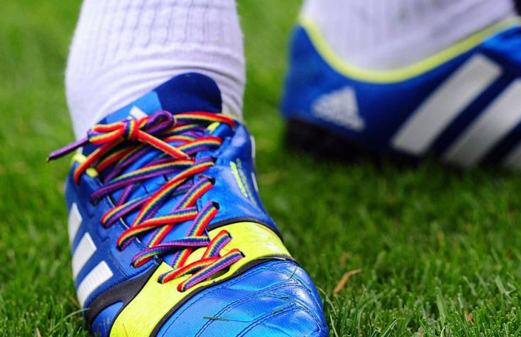 A footballer sports rainbow laces produced by LGBT advocacy group Stonewall Premier