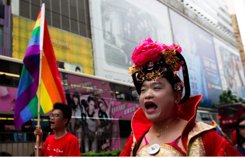 A pride march with a rainbow flag and a close up of a man in traditional chinese costume for women