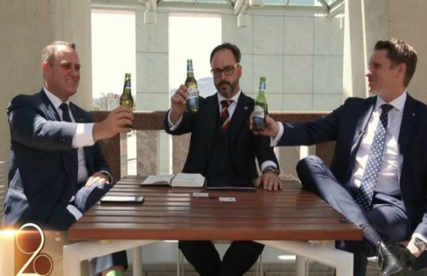 Tim Wilson (L) and Andrew Hastie (R) at Australia's Parliament House debating marriage equality in a Bible Society video which they claim was sponsored by beer company Coopers.