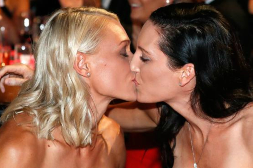 WNBA Adelaide Crows captain and ALFW MVP Erin Phillips kisses her wife. Photo: AFL Photos