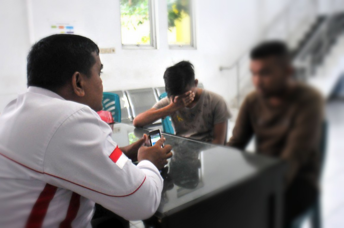Two men arrested on suspicion of being gay under Indonesia's Aceh province's Sharia Law. Photo: Twitter