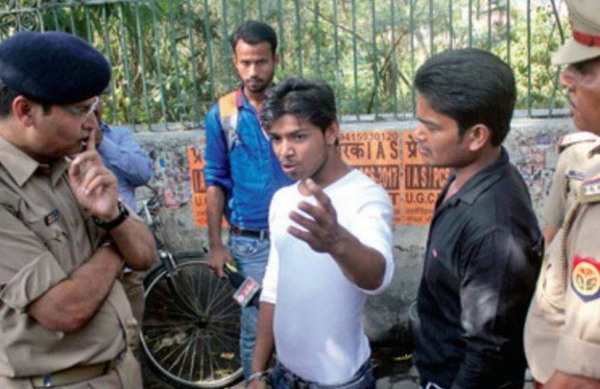 A man is questioned by an anti-Romeo squad in Agra, Uttar Pradesh. Photo: Twitter