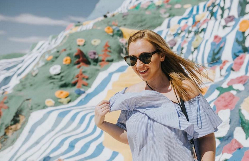 Meg takes in the sun at Salvation Mountain in California