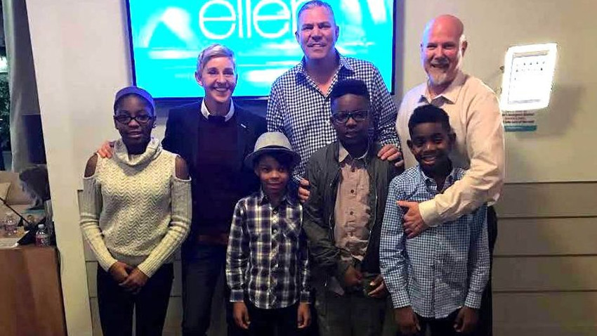 Ellen DeGeneres with Rob and Reece Scheer and their four adopted kids