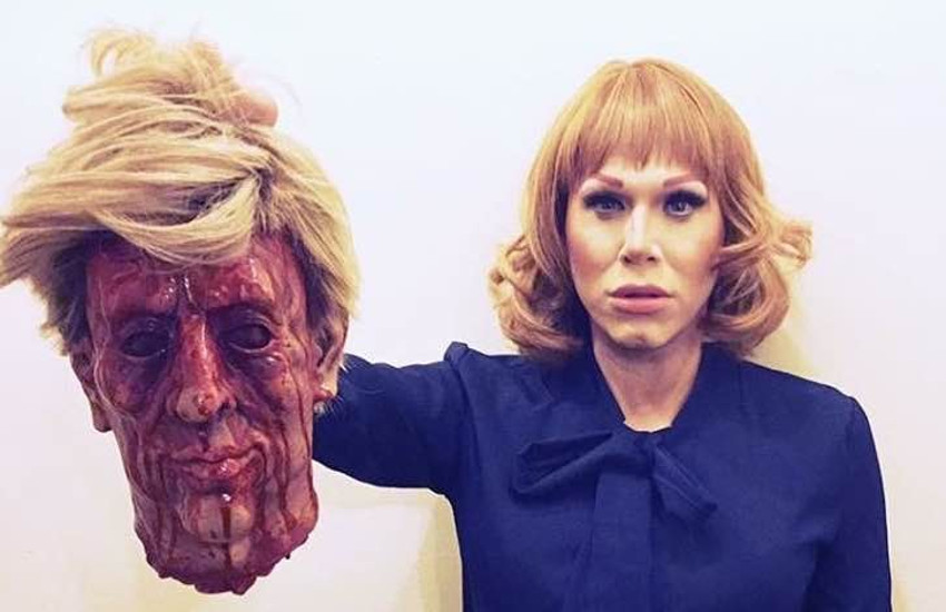 Drag performer Sharon Needles holds a fake decapitated head resembling Donald Trump