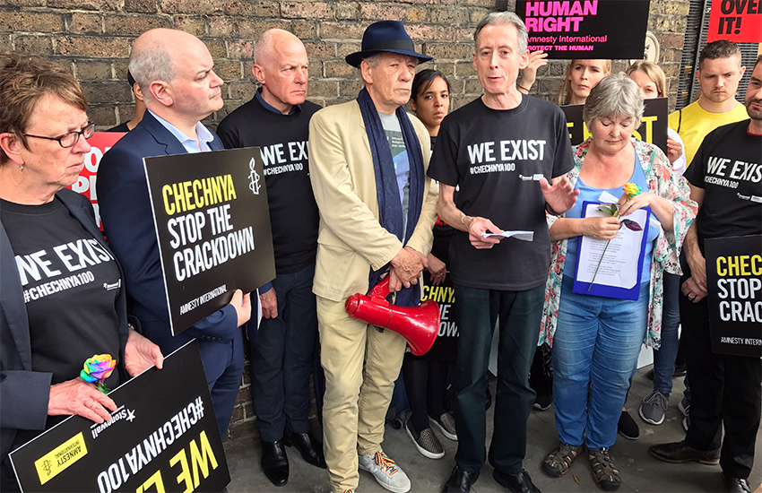 Actor Ian McKellen (center) joins others outside the Russian Embassy in London