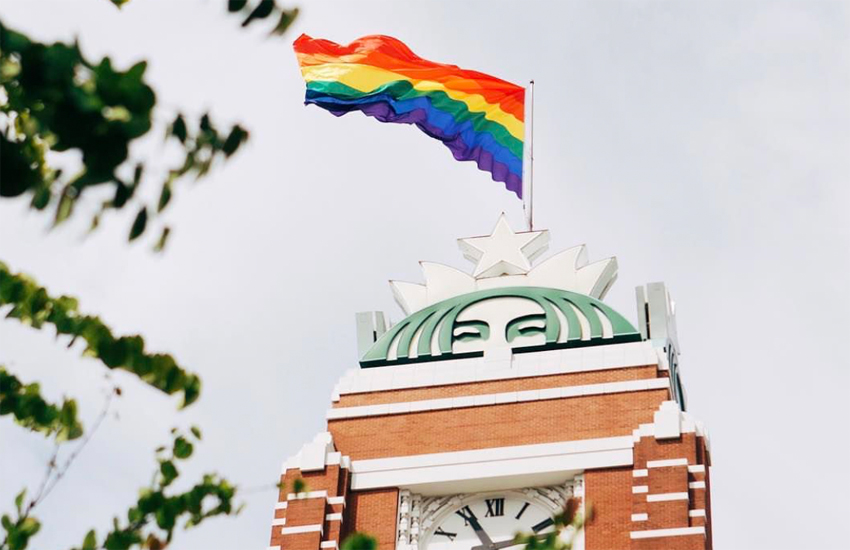 The rainbow flag flies above Starbucks headquarters in Seattle