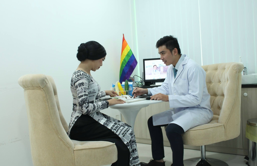A doctor at the Men's Health Center in Ho Chi Minh City in Vietnam helps a trans woman.