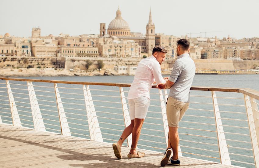 Two guys enjoy the view in Sliema: the capital, Valletta, can be seen across the water weekend