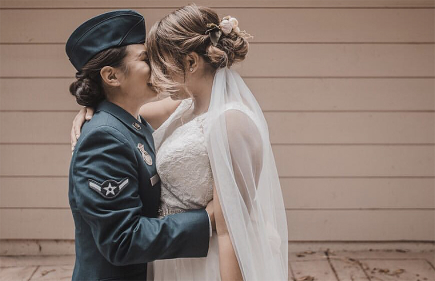 Rani and Cristine share a kiss on their wedding day