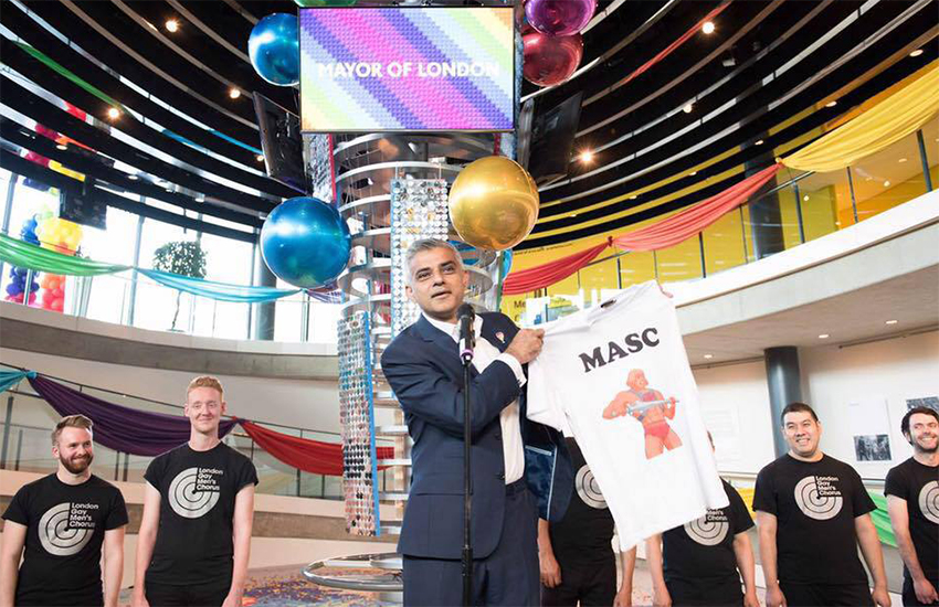 Mayor of London, Sadiq Khan holds up the T-shirt he nearly wore to Pride last year