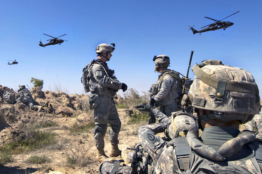 U.S. Soldiers wait to be picked up by helicopters south of Balad Ruz, Iraq, March 22, 2009. The Soldiers are assigned to Recon Platoon, 1st Battalion, 24th Infantry Regiment, 1st Stryker Brigade Combat Team, 25th Infantry Division. (DoD photo by Mass Communication Specialist 2nd Class Walter J. Pels, U.S. Navy/Released)