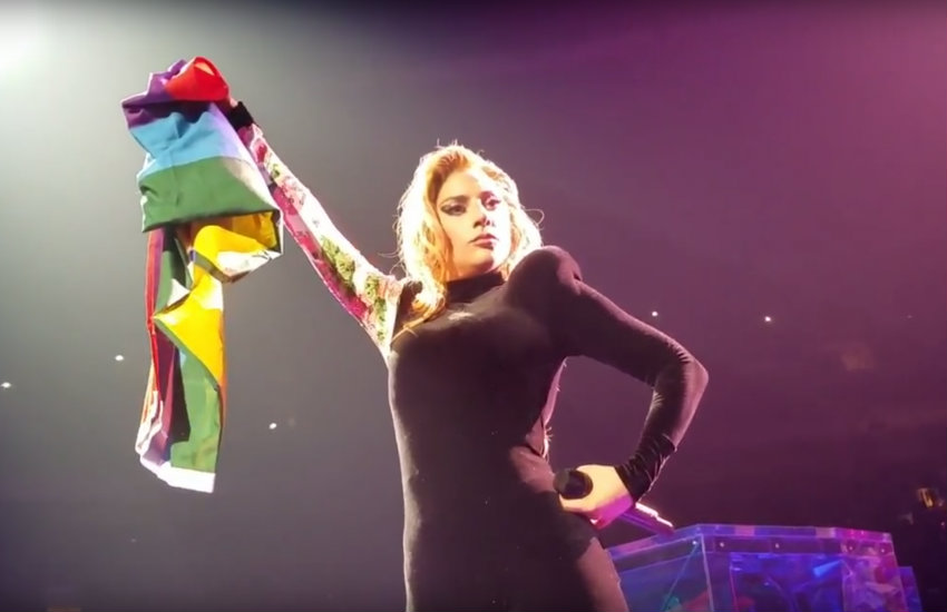 Lady Gaga holding a Pride flag at her concert in Vancouver
