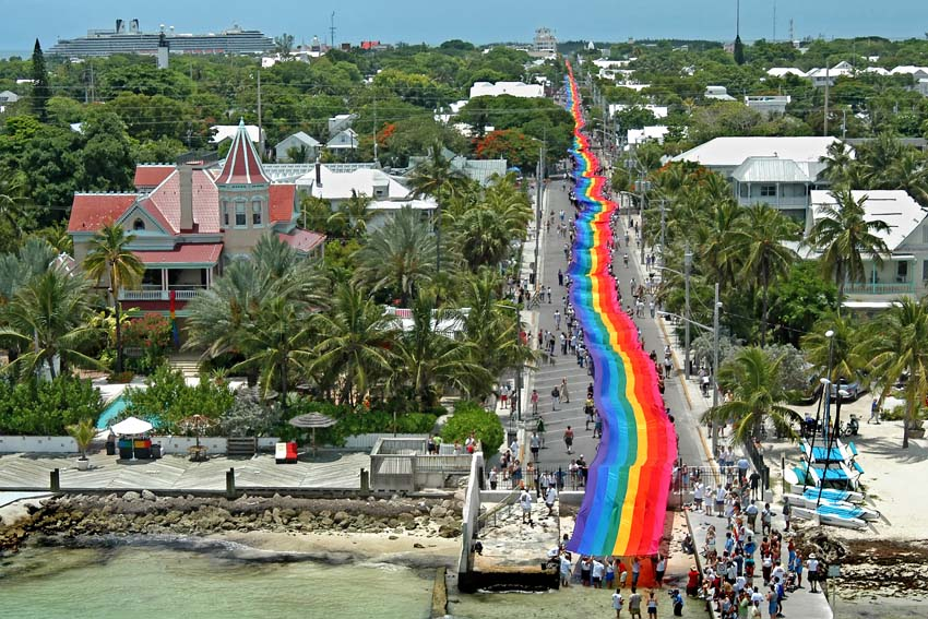 Volunteers carry a 1.25-mile-long rainbow flag in Key West, Florida