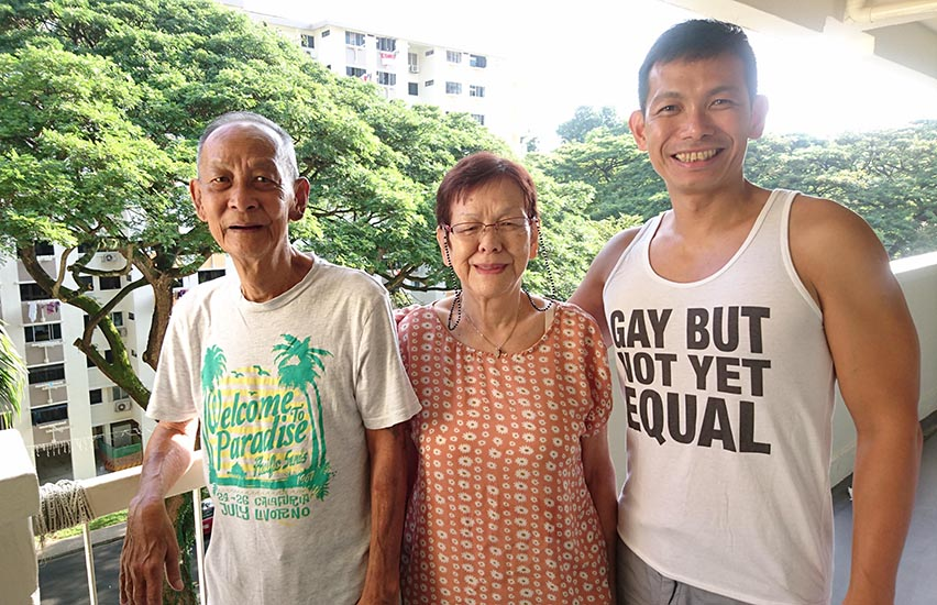 Koh Jee Leong with his parents, wearing the tank top that's caused controversy in Singapore.