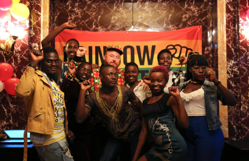 Ugandans and activists pose for a photo at secret pride party