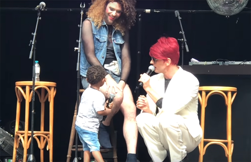 Two-year-old Giovanni takes the stage with Jonny Woo (right)