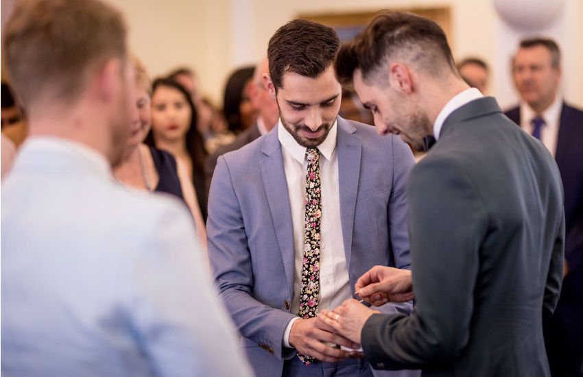 Steven presenting the ring for his identical twin brother James